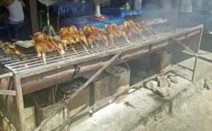 Another favorite of mine in Chiang Mai: grilled chicken, barbecued right on the street